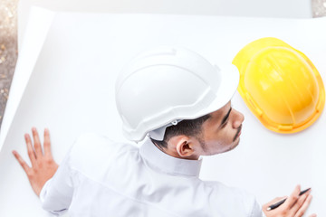 Architect working with construction tools and helmet safety on table