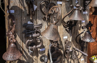 Old fashioned iron door bells and door handles for sale. Roussillon, Provence, France