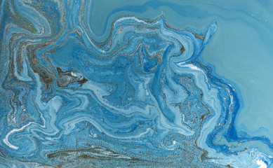 Marbled blue and golden abstract background. Liquid marble pattern