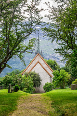 Old white church in Norway at sunny summer day