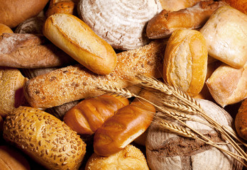 Zelfklevend Fotobehang Brood assortment of baked bread with wheat