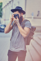 Street photographer taking pictures.