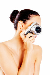 Nude beautiful woman with photo camera.