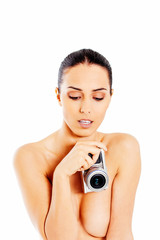 Nude beautiful woman with photo camera.