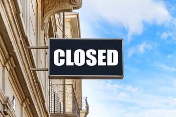 Closed sign at facade