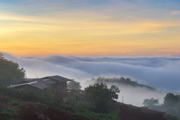 Small house in fog at sunrise