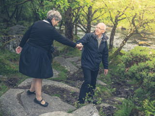 Senior couple walking in nature