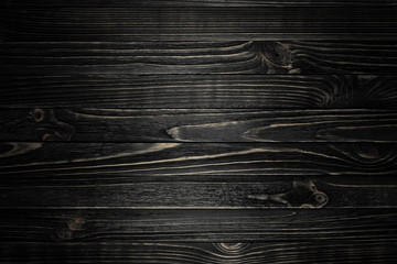 Black wood striped texture with vignette