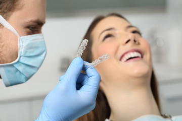 Dentist showing an implant to a patient