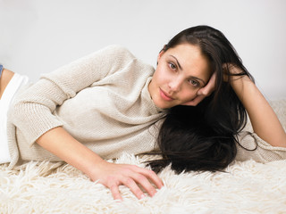 Woman laying on the floor smiling