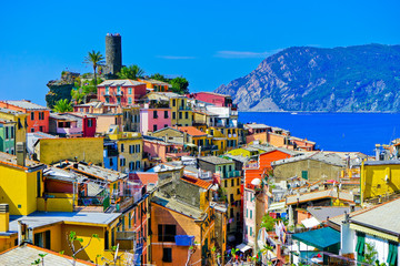 View of the colorful houses along the coastline of Cinque Terre area in Vernazza, Italy.