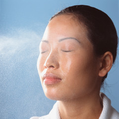 Water spraying on womans face