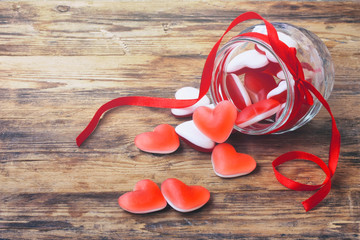 Marmalade candy shape heart in glass jar with ribbon