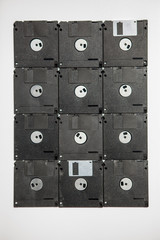Twelve floppy disks laid out in a rectangle