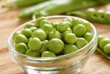 fresh peas on wooden background
