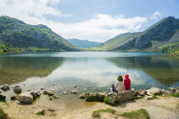 Beautiful nature of Spain: Covadonga mountain lakes in summer sunny day with blue sky and clouds