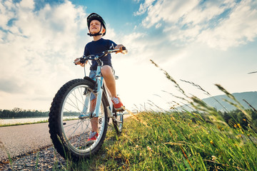 Boy start to ride a bicycle