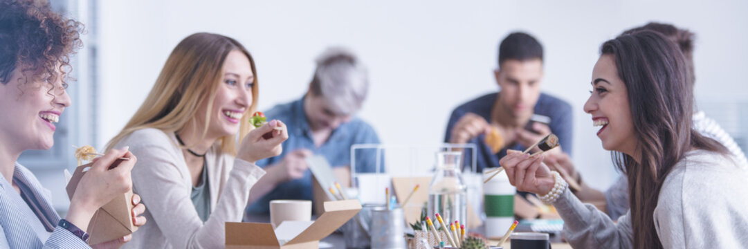 Multicultural interns during lunch break