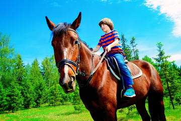 kid is riding a horse
