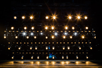 Spotlights & lighting equipment for the theater. Yellow light.