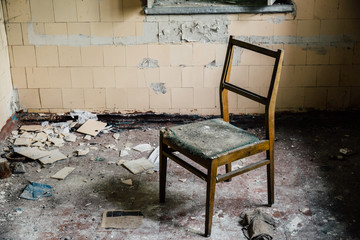 chair inside an old abandoned house