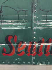 "The word ""Seattle"" on side of green truck, close up"