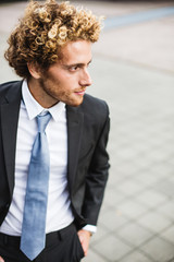 Portrait of young businessman in a suit and tie