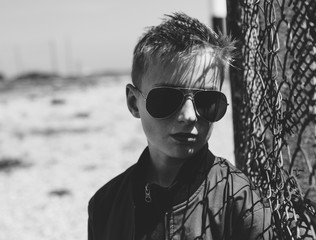 Black and white image of teenage boy in shades.