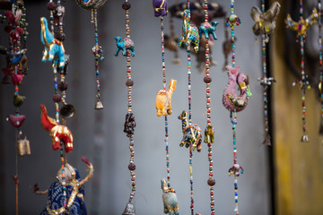 Decorative indian strings with animals, beads and bells.