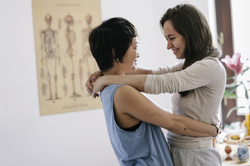 Affectionate lesbian couple embracing at home