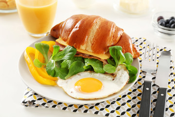 Tasty breakfast with fried egg on table