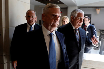 Secretary of Defense James Mattis and Secretary of State Rex Tillerson arrive to brief the Senate Foreign Relations Committee on the ongoing fight against the Islamic State on Capitol Hill in Washington