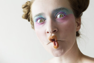 Ginger woman with dreadlocks and creative make up. Like a clown or princess
