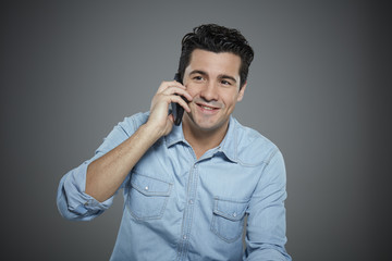 Portrait of young man talking on phone.