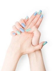 Woman hands with blue and green colored art nails polish. Isolated with clipping path