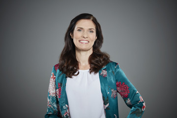 Portrait of mid adult woman wearing floral pattern jacket.