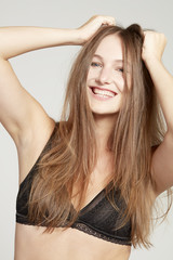 Smiling model with tousled hair.
