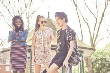 Teenage friends having fun at park