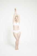 Model posing in white underwear.