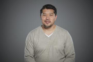 Portrait of mid adult man wearing sweater.