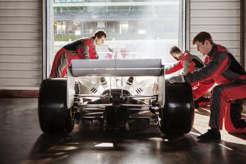 Pit Crew in pit garage