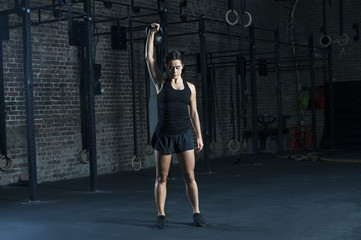 Young woman exercising with kettlebell