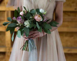 bride holds a wedding bouquet