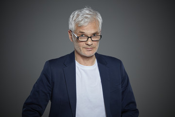Portrait of a mature man wearing a blazer.