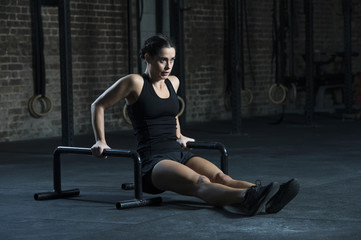 Young woman exercising with floor bars