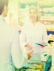 pharmaceutist  helping customer