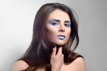 Beautiful young woman with creative make up on light background