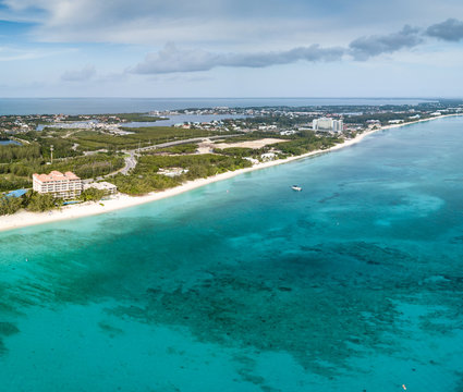 Aerial view of the tropical coral reef and seven mile beach of Grand Cayman island