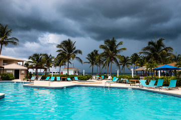 Stormy sky above a tropical swimming pool