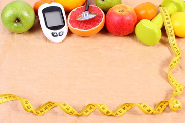 Glucose meter for measuring sugar level, stethoscope, centimeter and fresh fruits